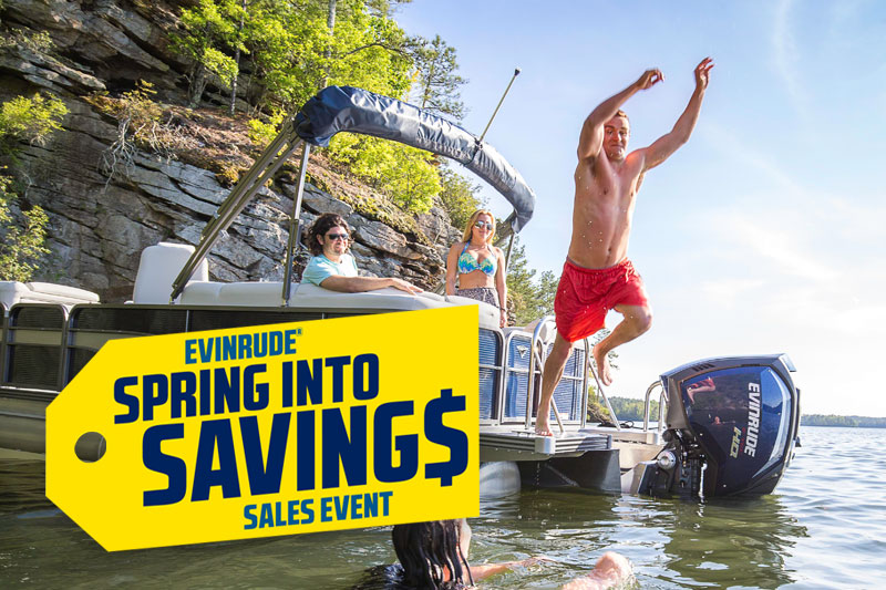 Evinrude Spring into savings sales event. Man jumping off boat into water.